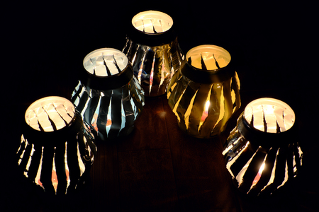 Handmade lantern that recycling from can of beer and fire by candle make amazing light rays at night