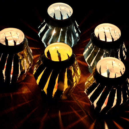 Handmade lantern that recycling from can of beer and fire by candle make amazing light rays at night Standard-Bild - 110640759