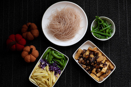 Food ingredients for dry rice vermicelli fried with vegetables from top view, a Vietnamese vegetarian dish for vegans, a dish can make quick for breakfast at home from noodle, vegetable, mushroom, tofu Stock Photo