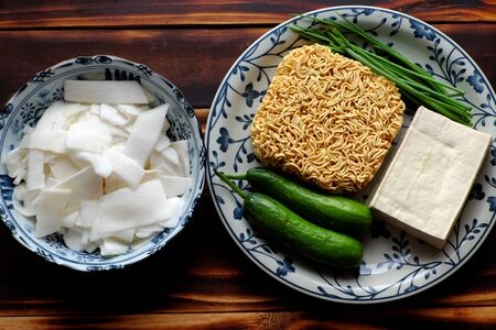Top view Vietnamese vegetarian food, fried noodles with sour bamboo shoots, cucumber and tofu on wooden background, a diet non meat only vegetables that quick, frugal
