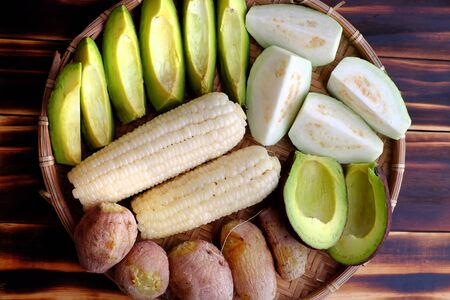 Top view food tray for vegetarian that quick, simple and cheap, trays of sweet potato, avocado, corncob, guava fruits, healthy lifestyle with non meat diet