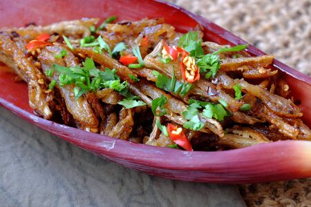 Close up of homemade Vietnamese food for vegetarian, banana flower vegan fish, a delicious eating from young bananas deep fry with crispy flour and soy sauce