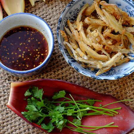 High view of homemade Vietnamese food for vegetarian, banana flower vegan fish, a delicious eating from young bananas deep fry with crispy flour and soy sauce Stok Fotoğraf
