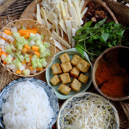 Prepare ingredients to cook Vietnamese vegetarian food,  bun mang, bamboo shoot noodles with tofu, mushroom, laksa leaves, herbs, an simple dish but delicious for vegan