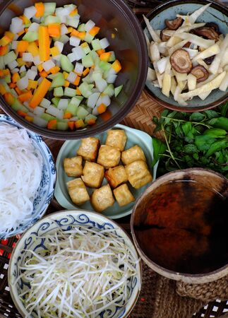Prepare ingredients to cook Vietnamese vegetarian food, bun mang, bamboo shoot noodles with tofu, mushroom, laksa leaves, herbs, an simple dish but delicious for vegan