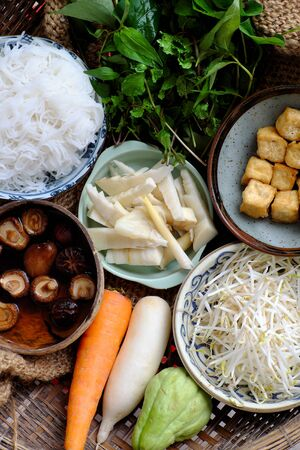Raw materials Vietnamese vegetarian food,  bun mang or bamboo shoot noodles with tofu, mushroom, laksa leaves, herbs, an simple dish but delicious for vegan 스톡 콘텐츠