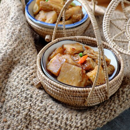 Close up Vietnamese vegan food, breadfruit cook with sauce for vegetarian meal on burlap background, a simple dish but delicious, nutrition, healthy.