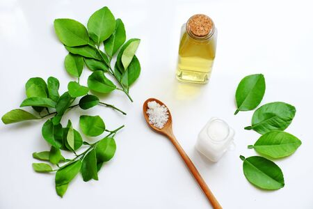 Homemade natural herbal oral care product from  lemon leaves and salt boil with water make yellow mouthwash for dental hygiene, treatment bacteria in oral cavity, make fresh breath Stok Fotoğraf