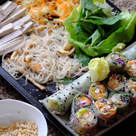 Close up sliced vegan rice paper rolls and Vietnamese spring roll ingredient, colorful vegetables make vegetarian dish that healthy and delicious