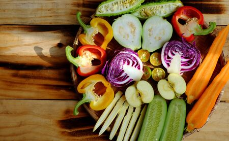 Prepare ingredient food for vegan mixed vermicelli with vegetables, red, yellow bell pepper, purple cabbage, coriander, cucumber, carrot, vegetarian raw material on wooden background