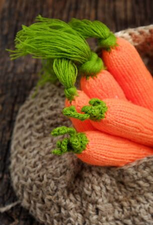 Amazing group knitted carrot with green leaf in jute rope basket, handmade product for home ornaments Stock fotó