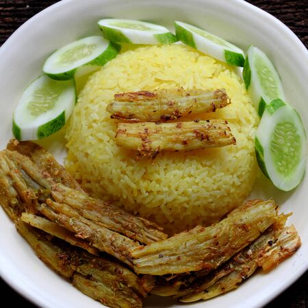 Vietnamese cuisine with vegan dish from vegetables, arrowroot marinated in salt, chili, citronella then deep fried make delicious vegetarian meal with cucumber and rice dish for dinner or lunch
