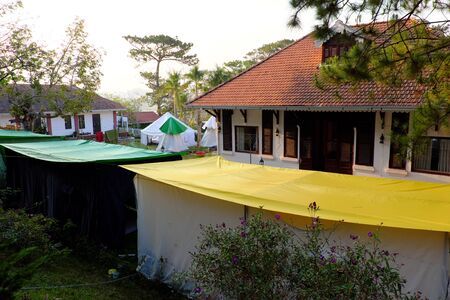 Exciting experience for self travel with tent, hotel with group outdoor camp under pine tree in spring at Da Lat city, Vietnam Imagens