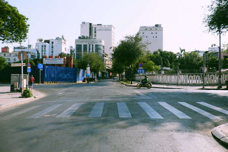 HO CHI MINH CITY, VIET NAM- APRIL 4, 2020: Deserted street, silent scene at central area of big city by request limit move around in pandemic, only few vehicle moving on day