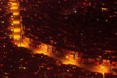 Sichuan Larong Wuming Buddhist College, night view Stock fotó