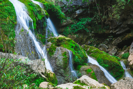 Scenery in Guizhou Maolan National Nature Reserve, river and waterfall in the forest