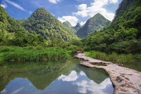Natural scenery of karst landforms in Xiaoqikong (Seven Small Arches) Scenic Area, Libo, Guizhou