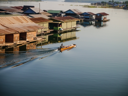 house float on water: Tail Boat and The Raft House in Kanchanaburi