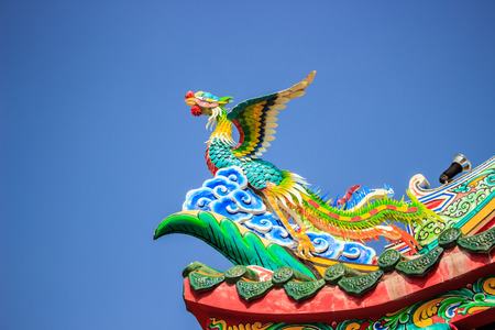 chinese buddha: Bird Statue in the Coner Roof with blue sky