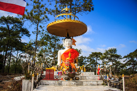 spiritual bless: white  Buddha statue with blue sky
