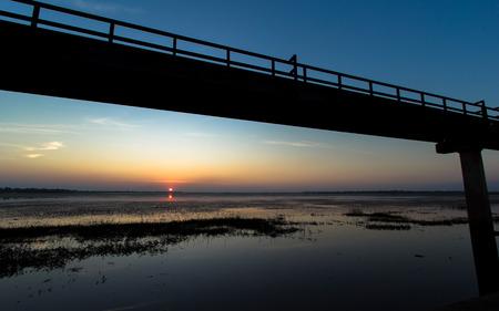 metal bridge by the reservoir , surin, thailand photo