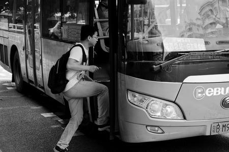get up: passenger get up the bus