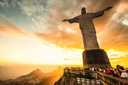 centralized: RIO DE JANEIRO, MARCH 3, 2013: Tourists are happy to see the first sunset after a week of rain and thunderstorms on the Corcovado Hill - march 3, 2013 in Rio de Janeiro, Brazil. In 2007 was elected one of the new seven wonders of the world.