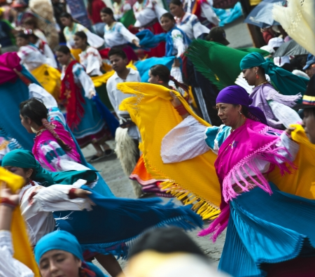 QUITO, DECEMBER 5, 2010: People in traditional Ecuadorean dresses dance as part of a parade through the streets celebrates its Spanish Foundation on December 5, 2010 in Quito, Ecuador Editorial