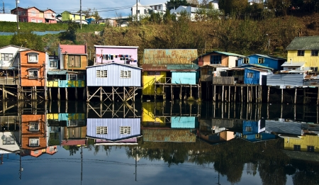 Palafitos Houses are distinctive examples of Chilote architecture  The large houses are located on the shores of the Gamboa River and the Lemuy Canal  They are supported by thick pieces of wood embedded in the ocean floor and covered in tile roofs  At low