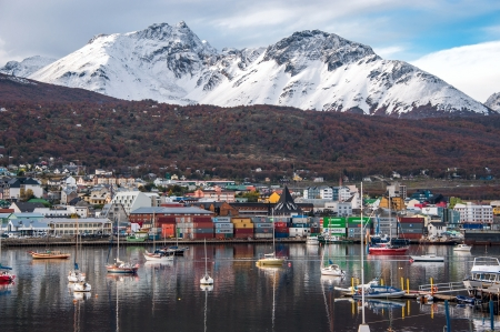 tierra: Reflection of the most southern city of Argentina in serene morning water of the Beagle Channel.Ushuaia is the capital of the Argentine province of Tierra del Fuego. Ushuaia is located in a wide bay on the southern coast of the island of Tierra del Fuego,