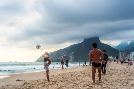 RIO DE JANEIRO, MARCH 2: Group of Brazilians play a game of keepie-uppie football (known locally as altinho) on the shore of Ipanema Beach - march 2, 2013 in Rio de Janeiro, Brazil