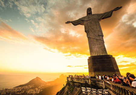 RIO DE JANEIRO, MARCH 3  Tourists are happy to see the first sunset after a week of rain and thunderstorms on the Corcovado Hill - march 3, 2013 in Rio de Janeiro, Brazil  In 2007 was elected one of the new seven wonders of the world