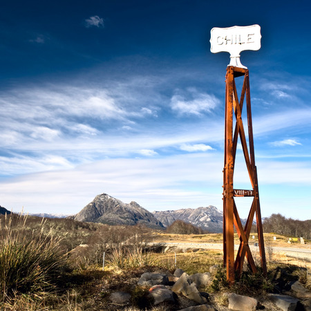 Vintage border post, Road sign at the Patagonia border of Argentina and Chile in Paso Cardenal Samore. Chile photo