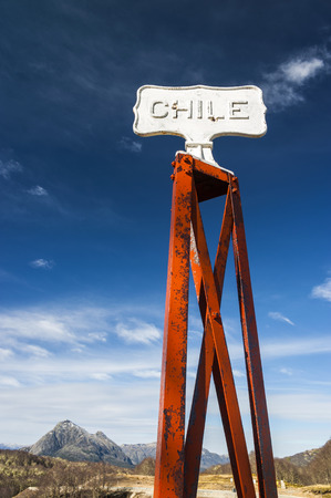 Chile Vintage border post, Road sign at the Patagonia border of Argentina and Chile in Paso Cardenal Samore photo