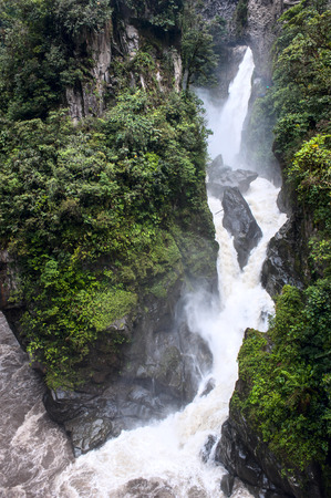 Pailon del Diablo - Mountain river and waterfall in the Andes. Banos. Ecuador photo