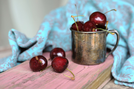 Sweet cherry in the Tin ancient mug