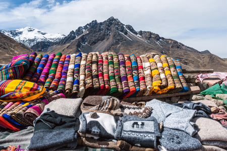 Traditional woven fabrics for sale at a tourist spot in the high Andes Stock Photo