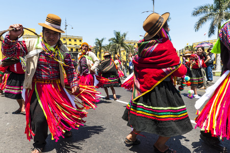 LIMA PERU MARCH 1  Indians in traditional peruvian dresses dancing in the square Plaza de Armas during the celebration of national independence on march 1 2011 in Lima, Peru  Plaza de Armas Is the birthplace of the city of Lima, as well as the core of the