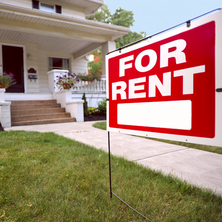 Home For Rent Sign in Front of Beautiful American Home Editorial