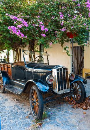 colonia del sacramento: Cobblestone street and old car in Historic neighborhood in Colonia del Sacramento, Uruguay.