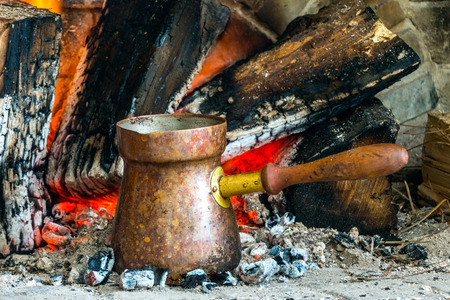 ideally: Turkish coffee is ideally cooked over some hot coals that have burned for a long time and settled into ashes Stock Photo