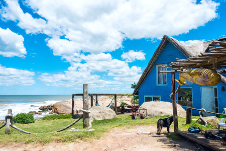 ignacio: Typical brightly colored houses on the picturesque beach in Punta del Diablo, popular tourist place in Uruguay