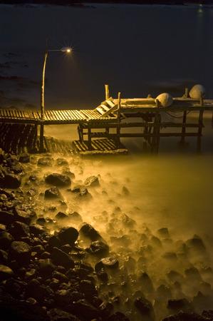 Small Dock at Tranquil Moody Night, Ecuador, Galapagos, Santa Cruz, Puerto Ayora photo