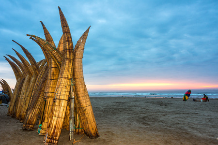 culture: Traditional Peruvian small Reed Boats (Caballitos de Totora), straw boats still used by local fishermens in Peru