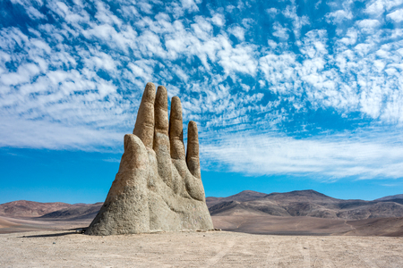 helplessness: Hand Sculpture, the symbol of Atacama Desert in Chile
