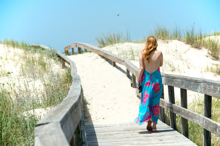 vast: Girl is walking in the vast sand dunes of the Uruguayan coast