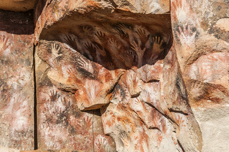 Paintings of ancient people in the Cave of the Hands (Spanish: Cueva de las Manos), Patagonia, Argentina Stock Photo