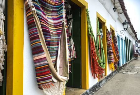 Parary, Rio de Janeiro, Brazil - February, 15, 2016: Hammocks, market place in the Old Town of Paraty (state of Rio de Janeiro). The colonial town dates back to 1667 and is considered for inclusion on UNESCO World Heritage List