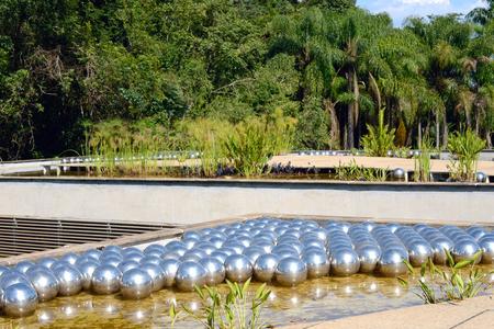 steel balls: Brunadinho, Inhotim, Minas Gerais, Brazil - FEBRUARY 2013: Yayoi Kusama Narcissus garden, stainless steel balls on water in the Inhotim Inhotim public contemporary art museum located in Brumadinho in the Brazilian state of Minas Gerais; founded by former  Editorial
