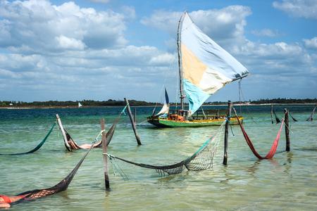 Sail boat and hammocks at the Paradise Lake (Jericoacoara, Brazil) Standard-Bild